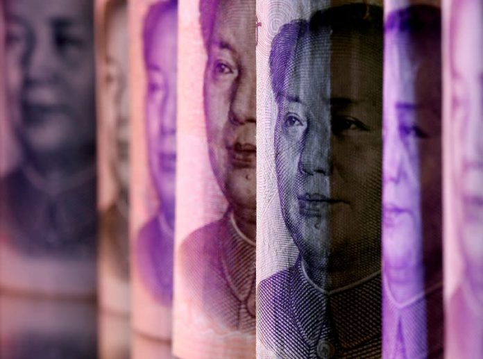 A central bank researcher should release the yuan to stimulate further use
