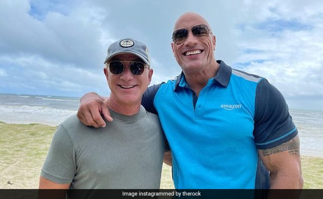 In this photo of Dwayne Johnson and Jeff Bezos