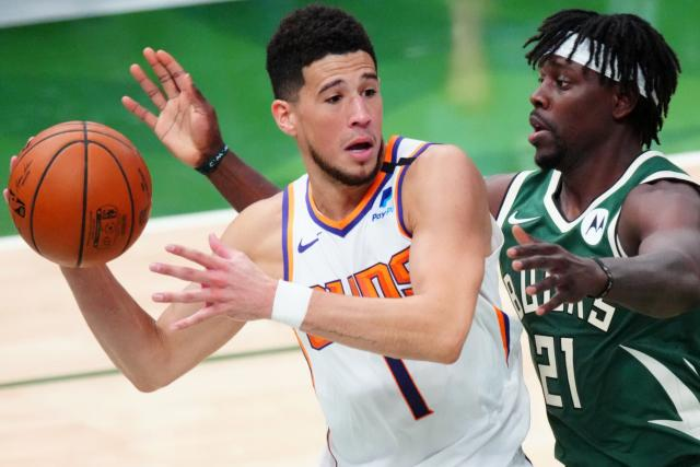 Devin Booker (Phoenix Suns) touches Milwaukee in Game Three of the NBA Finals