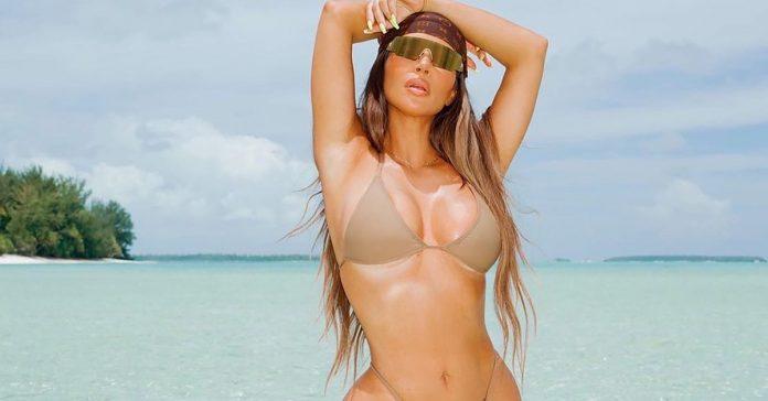 Single and happy: Kim Kardashian is stunning in a bikini in her forties