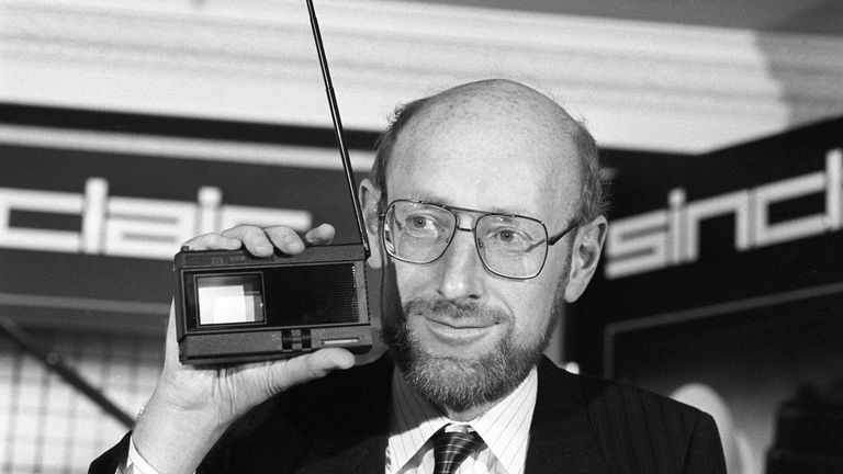 Sir Clive holding gadget in hand at the launch of the Sinclair 2-inch Pocket TV in 1983