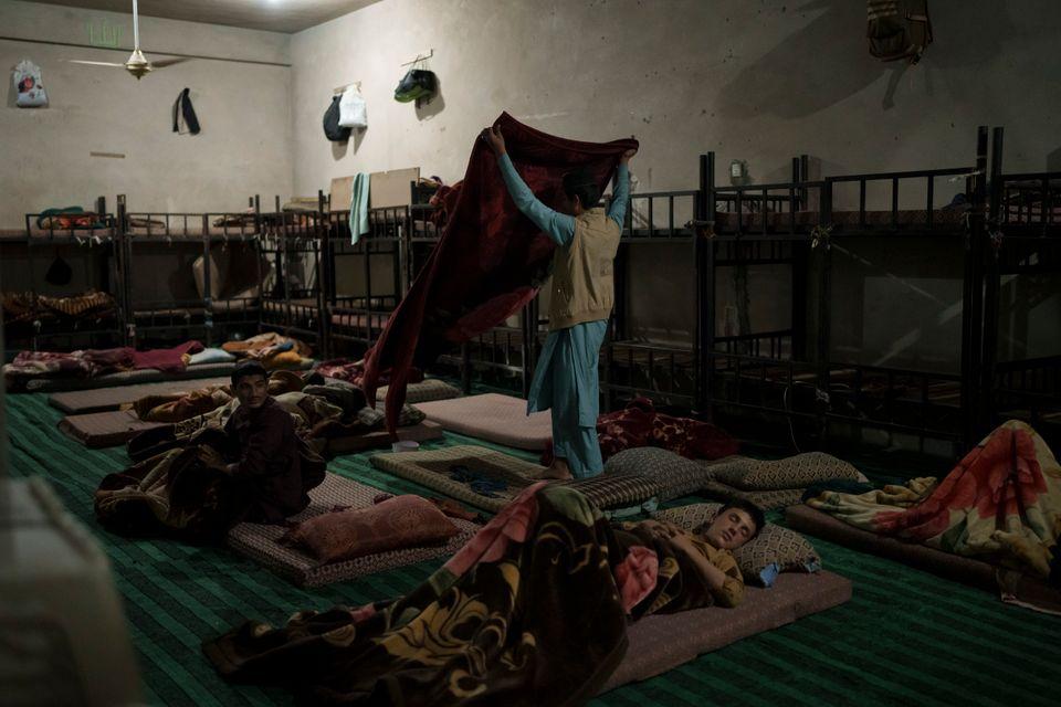 Afghan students wake up before dawn prayers at Khatam al-Anbiya School in Kabul, Afghanistan,...