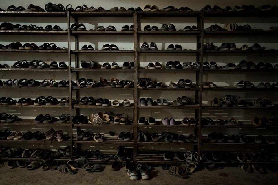 Students' shoes are placed at the entrance to the dining hall at the Khatam al-Anbiya School in Kabul,...
