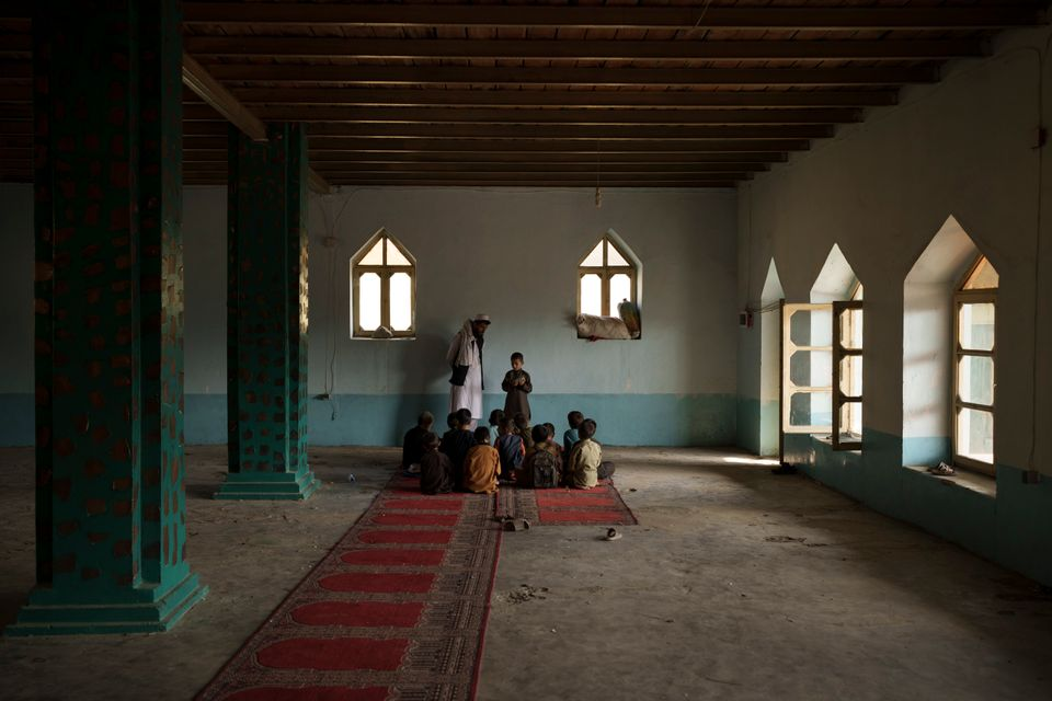 Afghan students read the Qur'an, Islam's holy book, at a religious school in Kabul, Afghanistan, Tuesday, September...