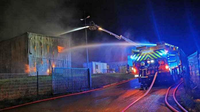 Aerosol warehouse affected by fire, fire controlled